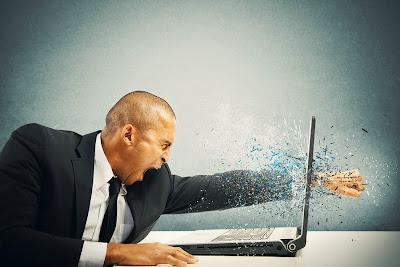 Man punching his Computer
