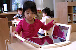 LePort Montessori Preschool Toddler Program Huntington Pier - girl observing herself at the mirror