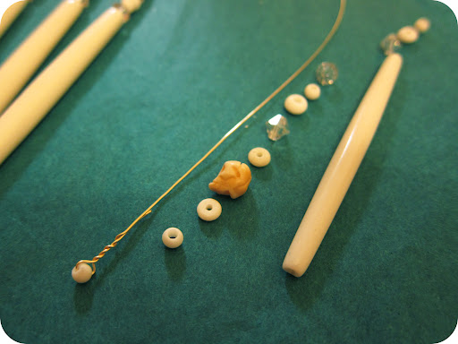 I created my own head pins with a long piece of 22-gauge gold wire and a mini bone bead twisted in the end.
