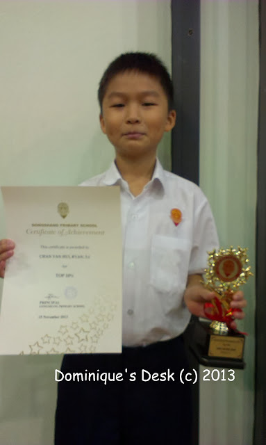Monkey boy with his certificate and trophy
