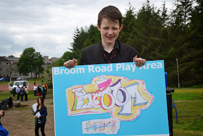 25-06-2013 - By Scott Campbell (+44) 0774 296 870 - Broom Road playpark's official opening, in Abronhill; Picture shows Abronhill High pupil, Joe with his design for park logo.