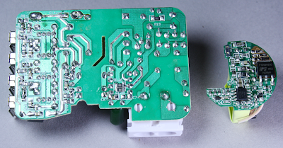 The circuit board from the KMS-AC09 charger on the left and a circuit board from the HP TouchPad charger on the right. Note the much higher density of the TouchPad board.