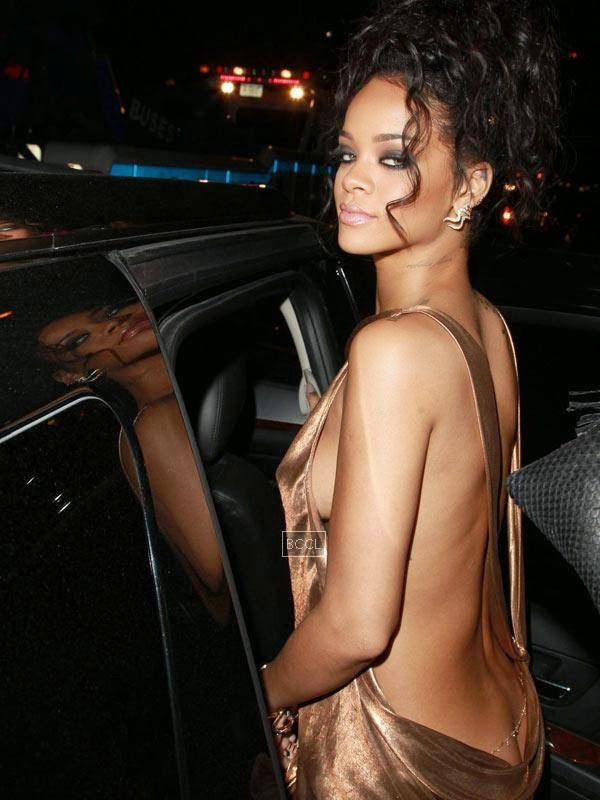 "Rihanna gave a new meaning to the ""peek-a-boo"" dress when she hosted the Met Gala 2014.Rihanna was glowing in her backless dress, showing just a peek of her booty."