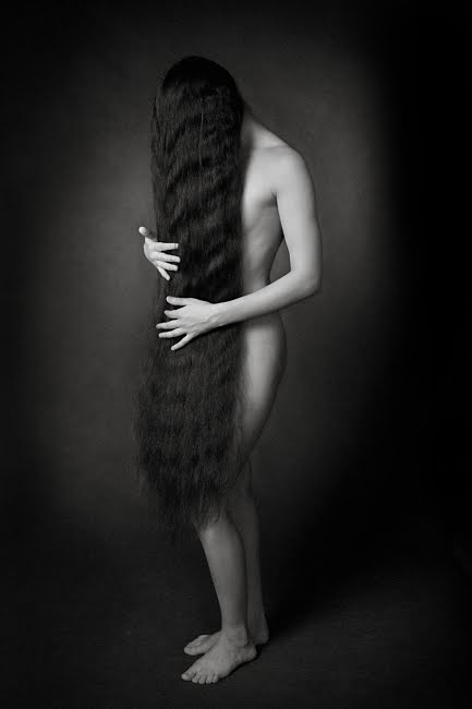 Lady modeling her very long hair weight loss spa