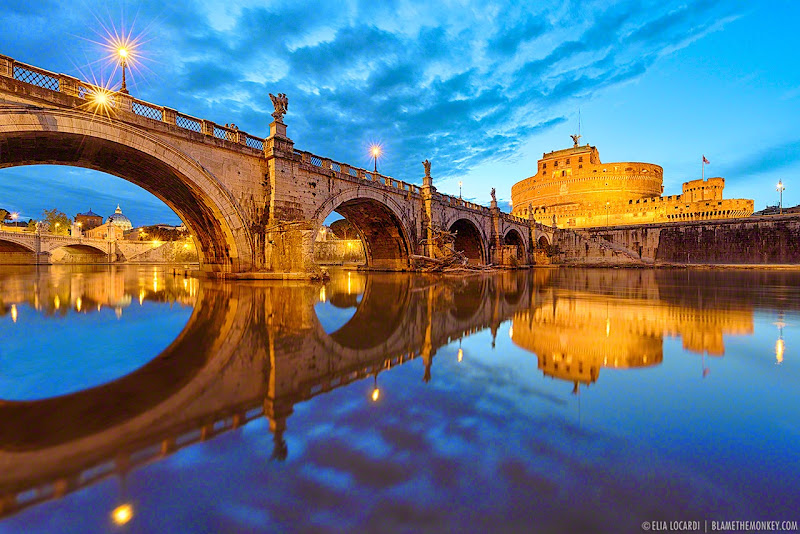A perfect moment of beautiful cloudy twilight over Ponte Sant Angelo in Rome, Italy. Photographer Elia Locardi