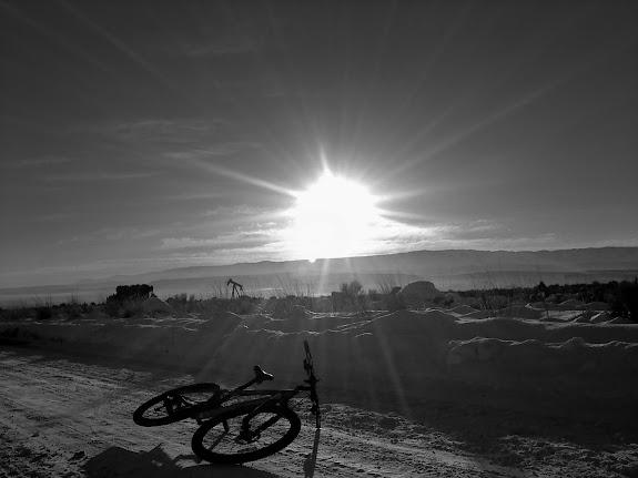 Bike, gas well, sun