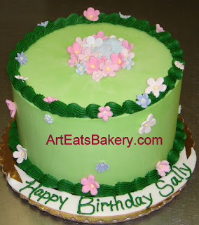 Custom green butter cream and sugar flowers birthday cake
