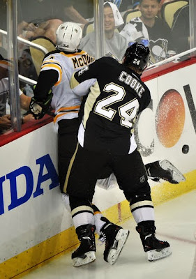 Penguins Matt Cooke hits Bruins Adam McQuaid from behind into the boards