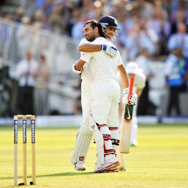 India's Ajinkya Rahane (L) celebrates his century with teammate Mohammed Shami during the first day of the second cricket Test match between England and India at Lord's cricket ground in London on July 17, 2014.