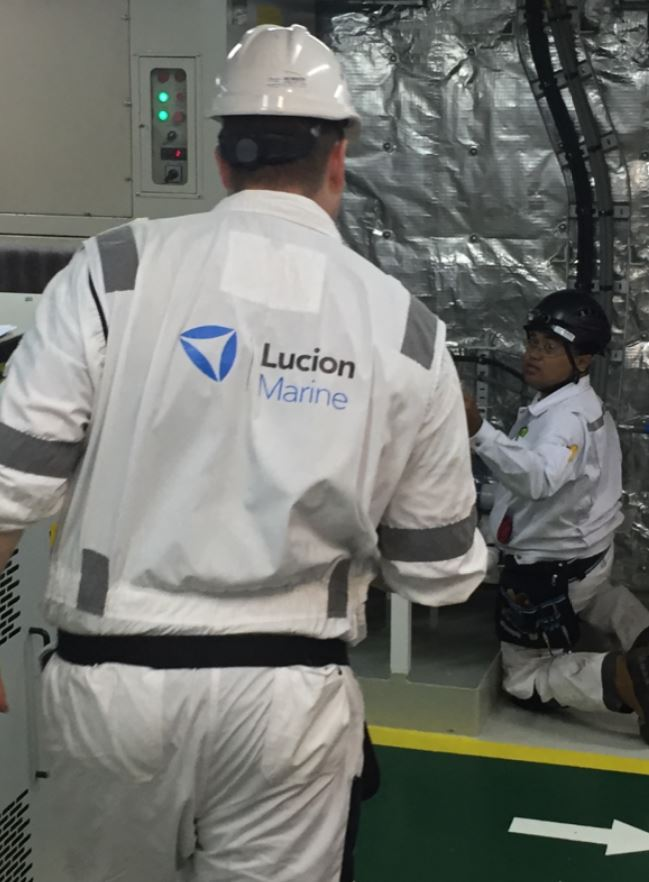 Asbestos removal technicians removing boiler condensate line