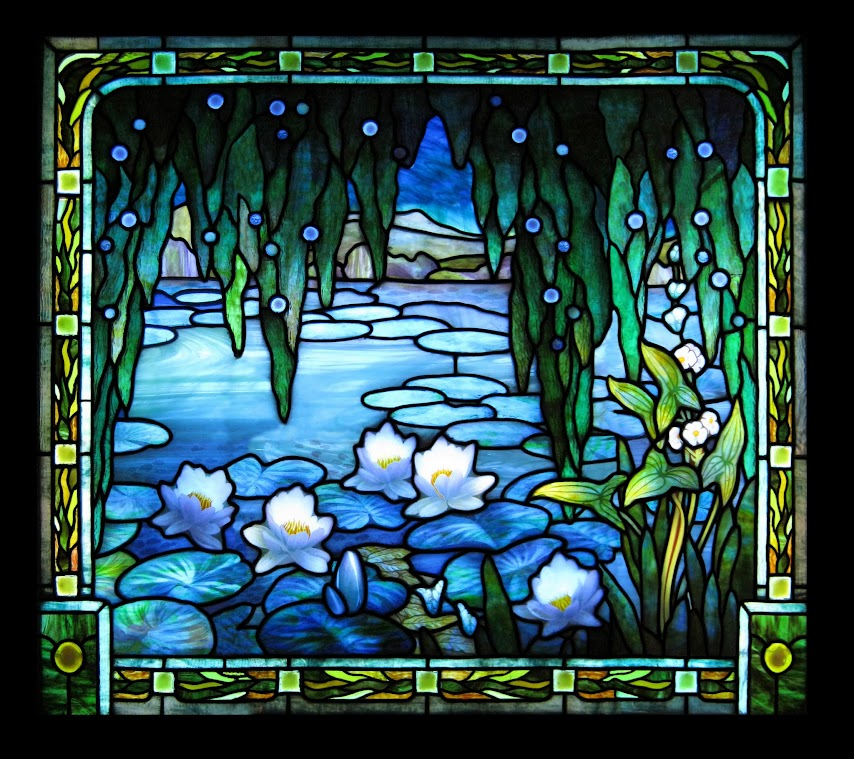A stained glass panel featuring a cypress tree and water lilies over a lake.