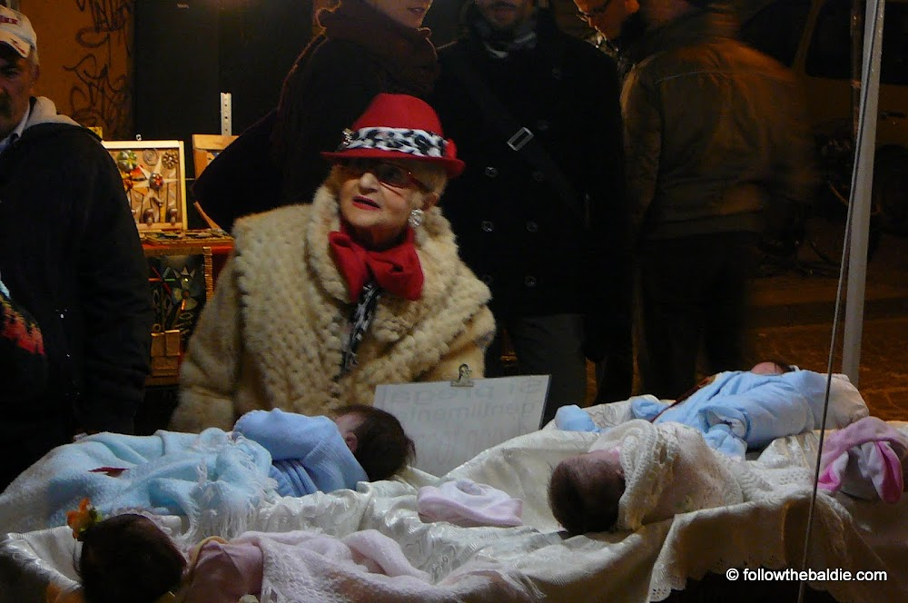 Wicked witch selling babies at neo-romantic Bologna street-fair: beyond the bounds of nicestalgia?