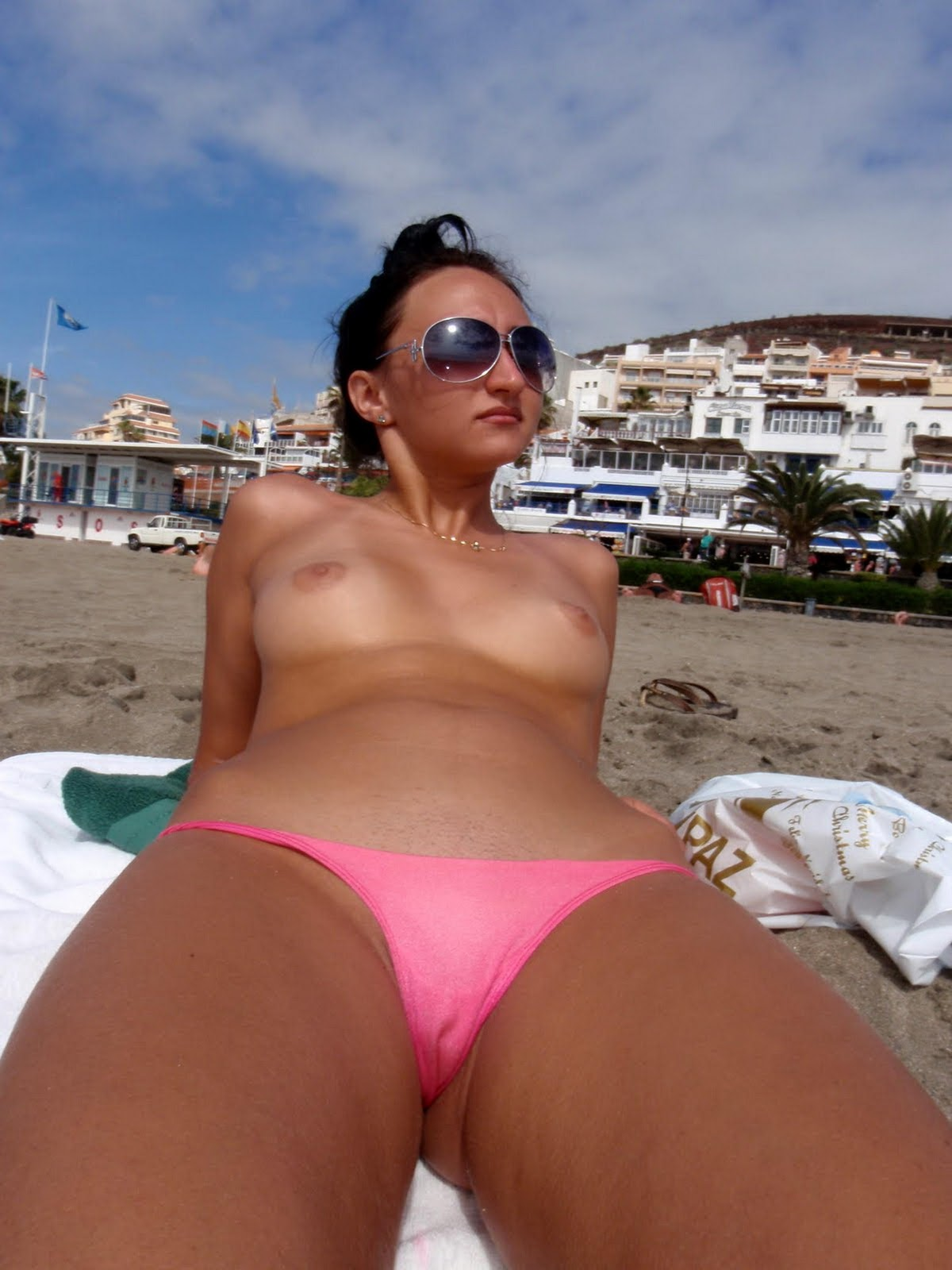 sexy european brunette topless on vacation at the beach