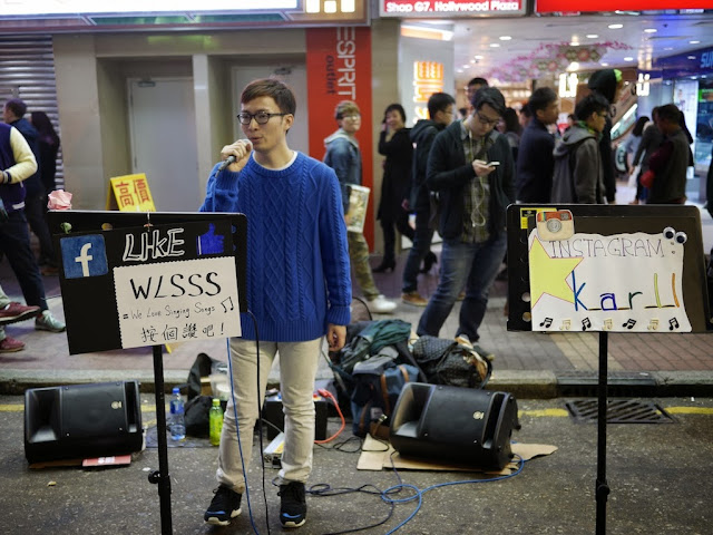 young man singing at Sai Yeung Choi Street South