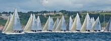 J/80s sailing upwind off start