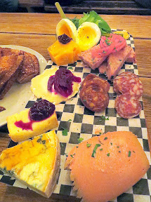 Brewstillery Festival preview of the StormBreaker Smorgasboard, a Cheese Plate combined with their Meat Plate that includes Olympic Provisions Selection meats and mousse and sliced bread that adds a soft boiled egg and simple salad, all for $14