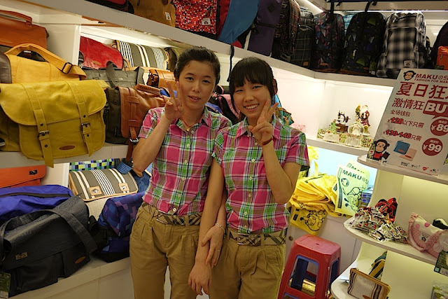two young women working in a bag store at Dongmen in Shenzhen, China