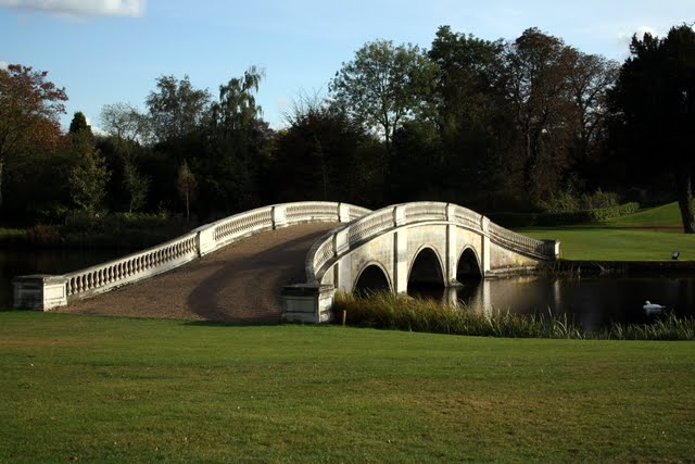 Bridge spanning a pond on the golf course at the Stoke Park Hotel in Buckinghamshire England