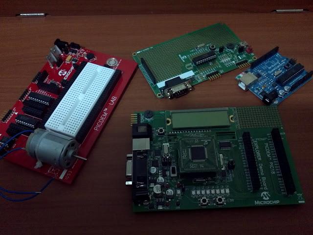 four microcontroller development boards
