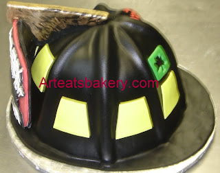 Custom unique sculpted black fondant firefighter's helmet with sugar eagle holding the front plaque