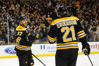 Patrice Bergeron #37 and Loui Eriksson #21 of the Boston Bruins celebrate a goal against the Toronto Maple Leafs