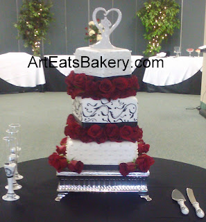 Three tier off set square custom elegant black swirls, pearls and red roses wedding cake design 2