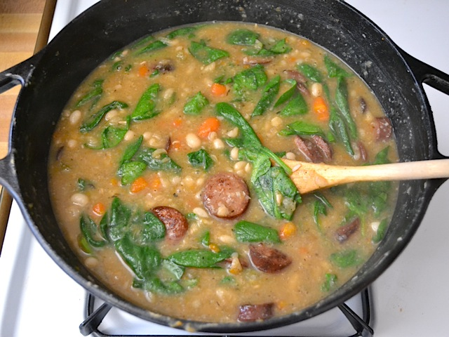 fresh spinach added to the navy bean soup