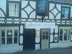 Old whitewashed & black beamed style pub turned restaurant frontage