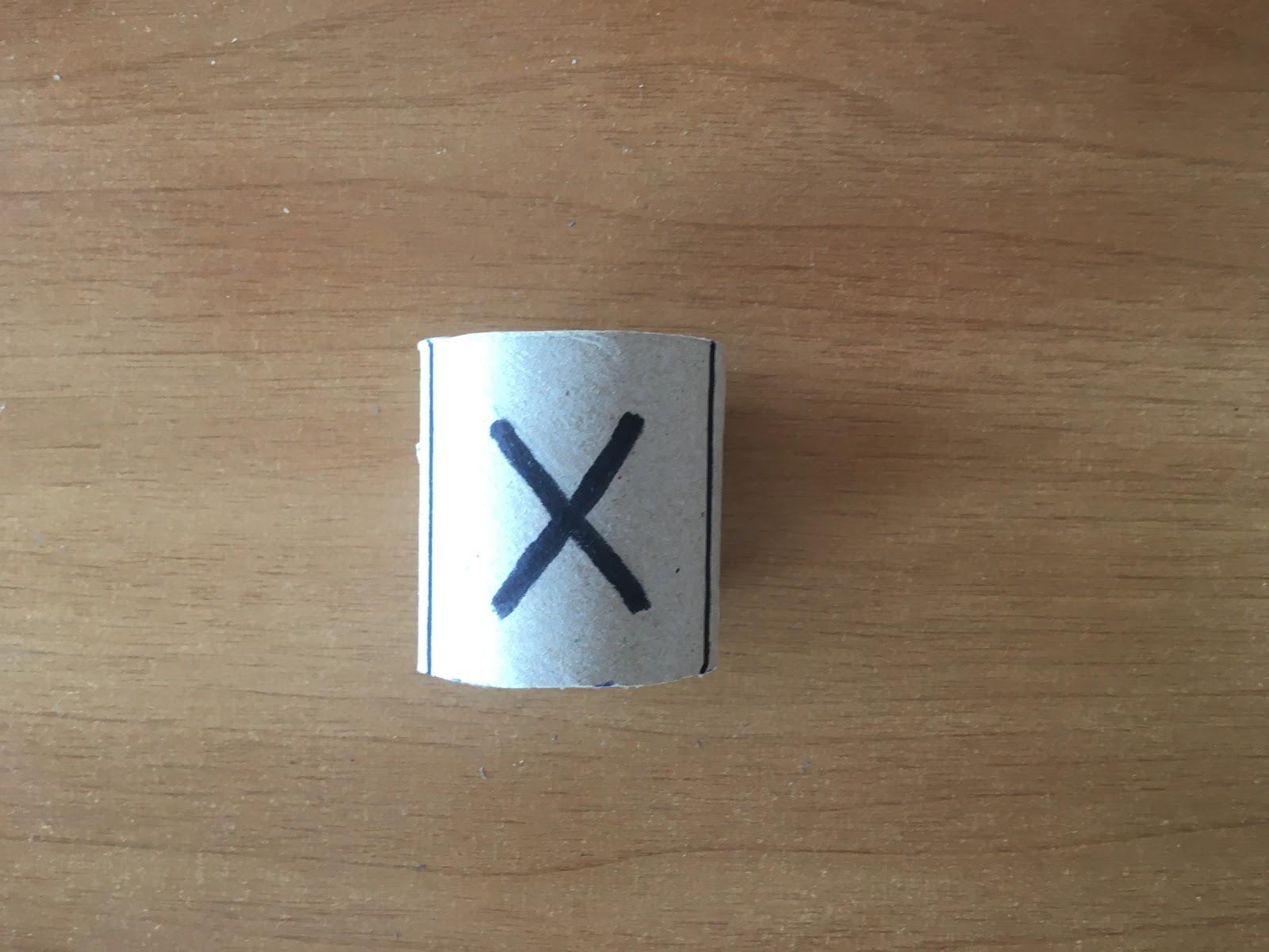 """Trazado de una """"X"""" en una de las caras."""