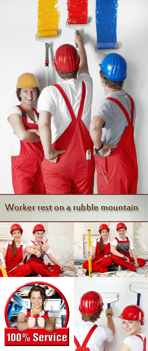 Stock Photo: Worker rest on a rubble mountain while fixing up a house
