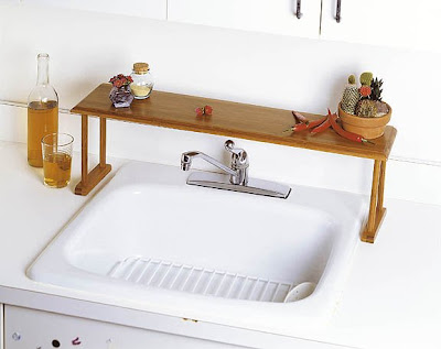 Epic This bamboo over the sink shelf from Organization Makes Sense can be used in either the bathroom or the kitchen and is especially useful to keep things