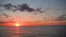 sunset on lake huron, michigan