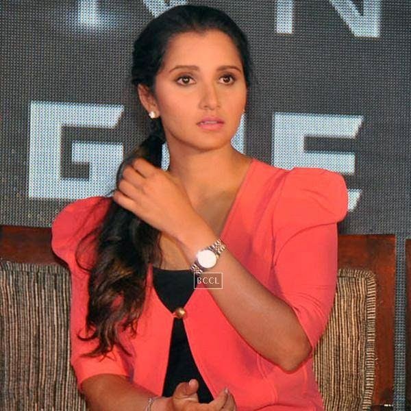 Sania Mirza gets clicked during the launch of Celkon's Millennium Vogue Q455 in Mumbai, on July 25, 2014. (Pic: Viral Bhayani)