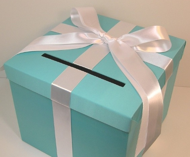 Light blue box with white bow and slot