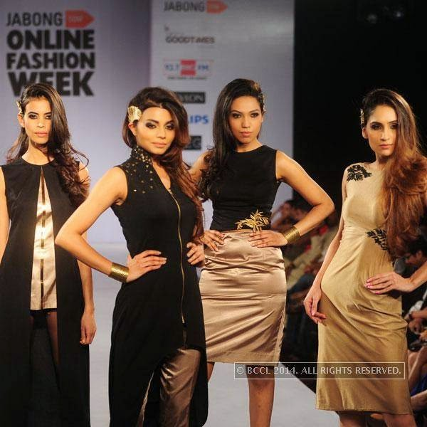 Models walk the ramp during Jabong Online Fashion Week, held at Hotel Le Meridian, in Delhi, on July 30, 2014.