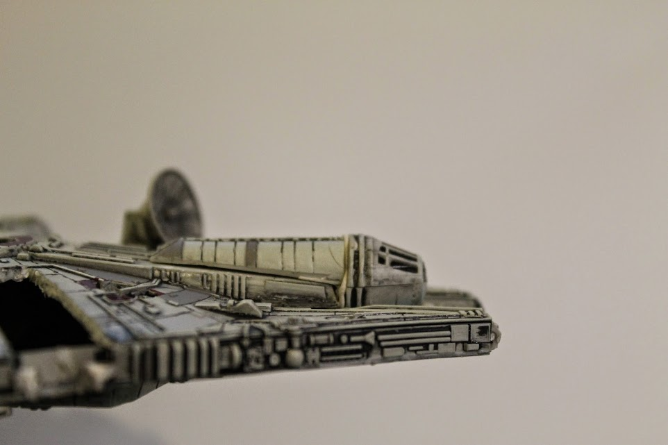 Millennium Falcon model cut open, with cockpit fixed back on. Side View.