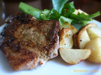 Seared rosemary pork chop and roasted red potatoes