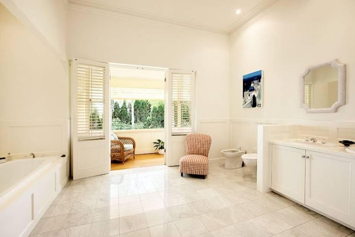 Bathroom and balcony at 59 Kensington Road SOUTH YARRA