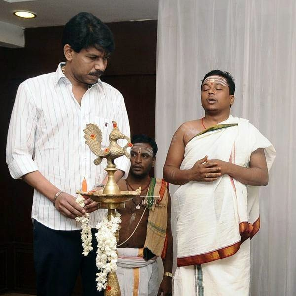 Bala lights the traditional lamp during the movie pooja of Thaarai Thappattai, held in Chennai.