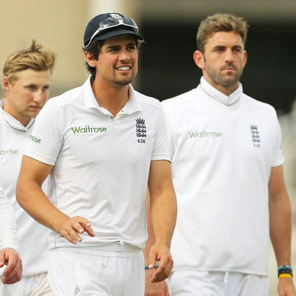 England captain Alastair Cook (2R) leads his team from the pitch after the match was drawn on the final day of the first cricket Test match between England and India at Trent Bridge in Nottingham, central England on July 13, 2014.