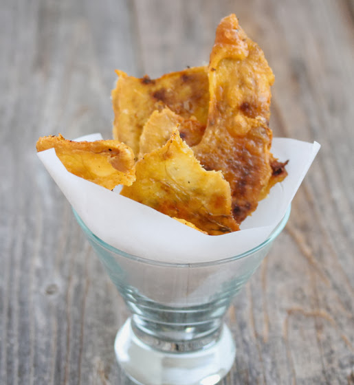 baked chicken cracklings in a glass