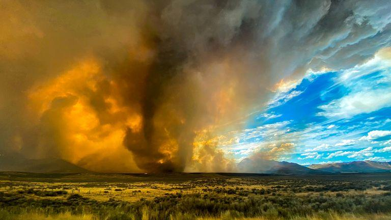 Funnel appearing in thick plume of smoke from the Loyalton Fire is seen in Lassen County, California, U.S. August 15, 2020, in this image obtained from social media. Courtesy of Katelynn Hewlett/Social Media via REUTERS. ATTENTION EDITORS - THIS IMAGE HAS BEEN SUPPLIED BY A THIRD PARTY. MANDATORY CREDIT KATELYNN HEWLETT. NO RESALES. NO ARCHIVES.