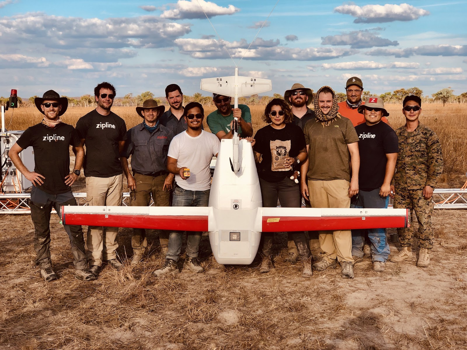 The Zipline team with one of their drones.