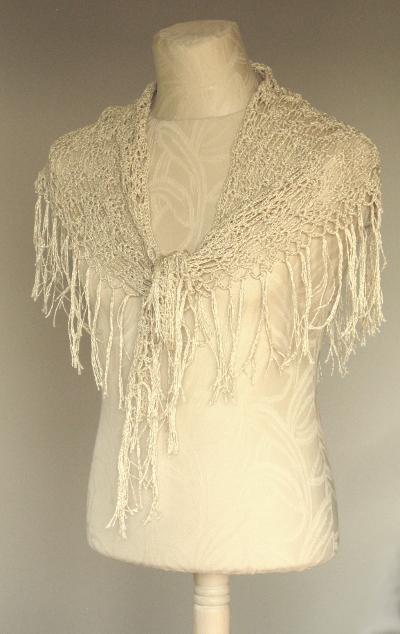Dressform wearing a crochet scarf