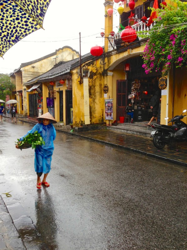 hoi an ladies fruit streets rain ancient town