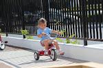 LePort Montessori Preschool Toddler Program Huntington Pier - girl on a tricycle