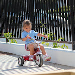 LePort Montessori Preschool Toddler Program Huntington Pier - girl on a tricycle