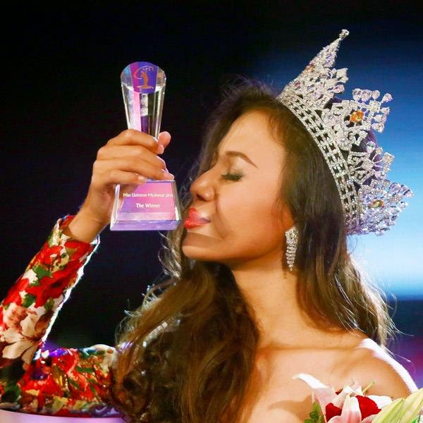 Miss Universe Myanmar 2014 Sharr Htut Eaindra kisses her trophy after being crowned during the Myanmar Miss Universe competition at Myanmar National Theatre in Yangon July 26, 2014.