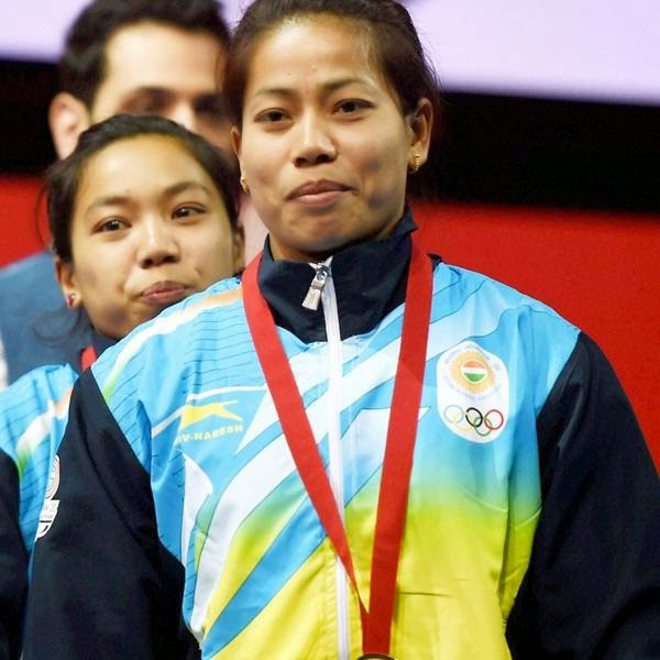 India's gold medalist Sanjita Khumukcham and compatriot silver medalist Chanu Saikhom during the medal presentation ceremony of 48-kg women's weightlifting event at the Commonwealth Games in Glasgow, Scotland.