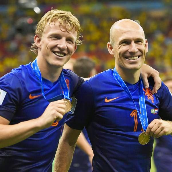 Netherlands' forward Arjen Robben (R) and Netherlands' defender Dirk Kuyt (L) salute the crowd after winning the third place play-off football match between Brazil and Netherlands during the 2014 FIFA World Cup at the National Stadium in Brasilia on July 12, 2014.